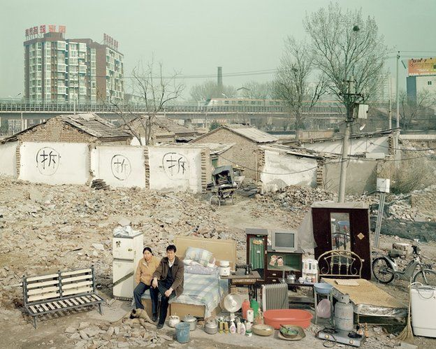 Chinese couple by demolition site