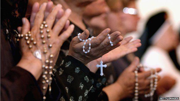 Women holding rosaries
