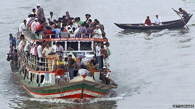 Overcrowded ferry in Dhaka
