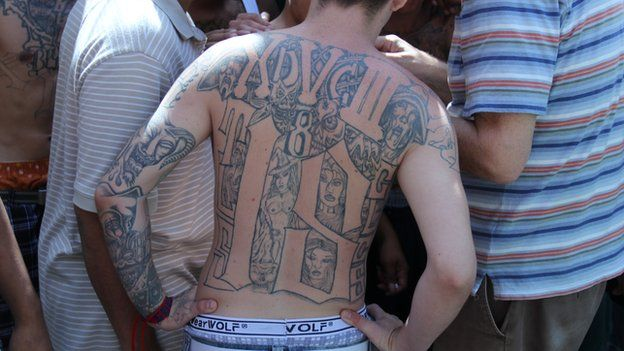An 18th Street gang member with a tattooed back