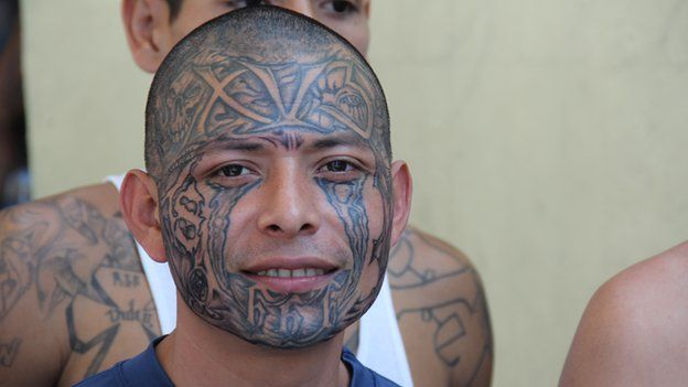 An 18th Street gang member with a tattooed face