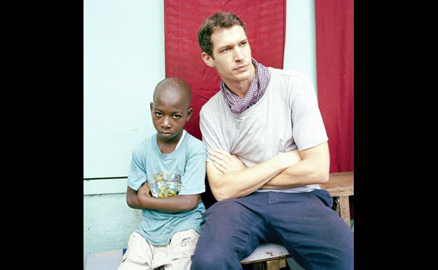 With a young boy in west Africa - Tim Hetherington/Magnum