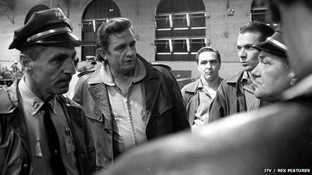 Johnny Cash talking to prison guards at San Quentin prison