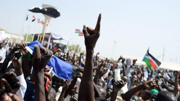Sudanese celebrate following the announcement of the preliminary results in the Southern Sudan referendum in Juba on January 30, 2011