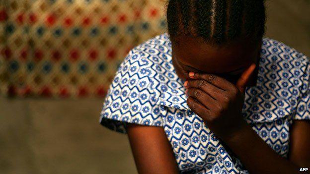 DR Congo rape victim talking to health worker
