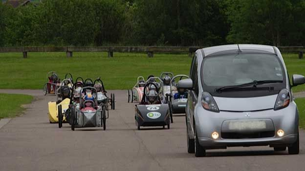 Callum Burnett's Imiev as the pace car in a electric cart race