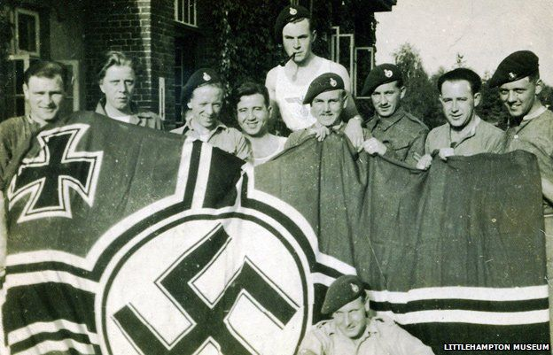 30AU posing with a captured German flag