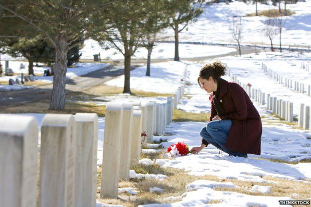 Mourner laying flowers