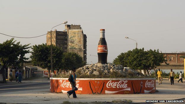 Coca Cola bottle advertisement in centre of roundabout in Maputo