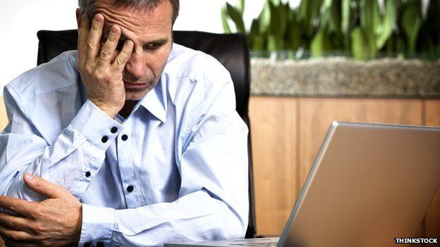 Generic image of a man looking exasperated at his laptop computer