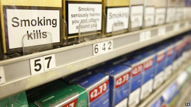 Cigarettes displayed in cabinet