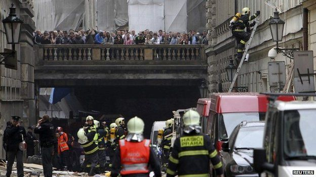 People look on as emergency services attend the scene