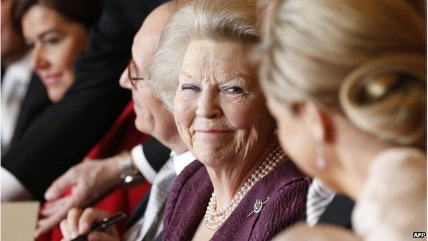 Queen Beatrix signs the deed of abdication