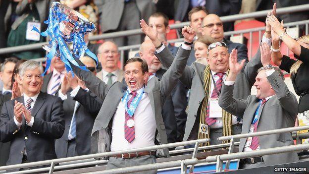 Manager Justin Edinburgh celebrates after the match