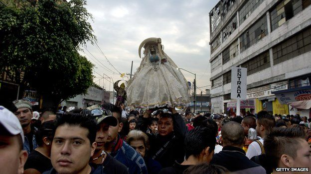 A statue of Santa Muerte is carried through the streets of Mexico City on 1 November 2012
