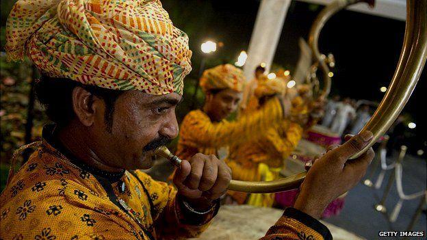 Man playing traditional Punjabi horn