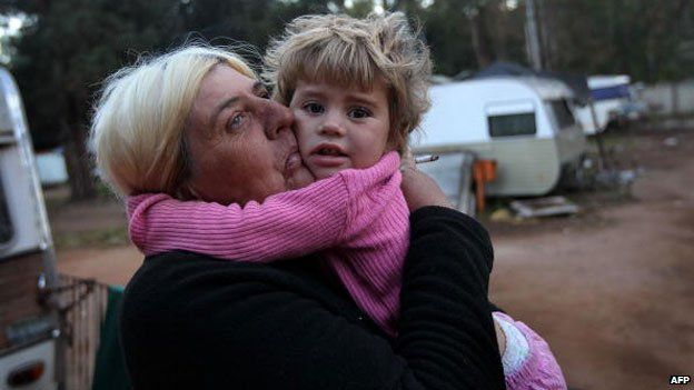 Woman and child at Krugersdorp squatter camp, June 2010