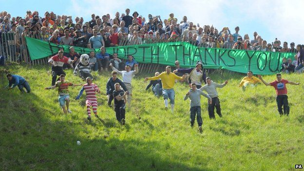 Some 3,000 spectators gathered on Cooper's Hill in the bank holiday sunshine