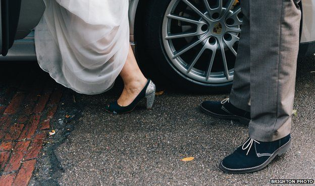 Details of the bride and groom's feet as they get into the wedding car