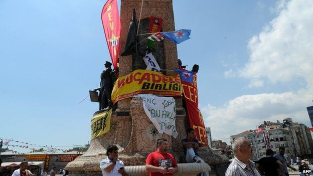 Protesters stand around the Republic monument on Taksim square in Istanbul, 3 June 2013