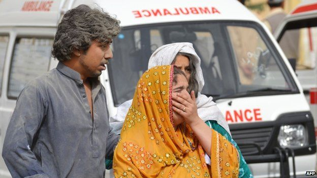 Civilians emerge from the hospital attacked in Quetta, Pakistan, 15 June