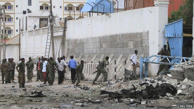 Somali government soldiers arrive to secure the United Nations compound following a suicide bomb attack in the capital Mogadishu, 19 June 2013