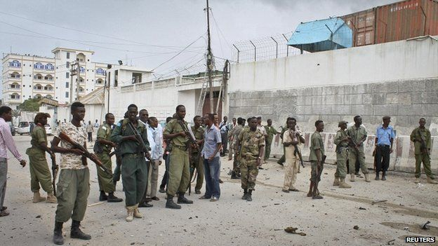 Somali government soldiers gather in front of the UN compound - 19 June 2013