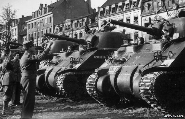 General Lattre de Tassigny, Commander in Chief of the French armies in France, inspecting the Allied Sherman tanks which liberated the French city of Colmar in 1945