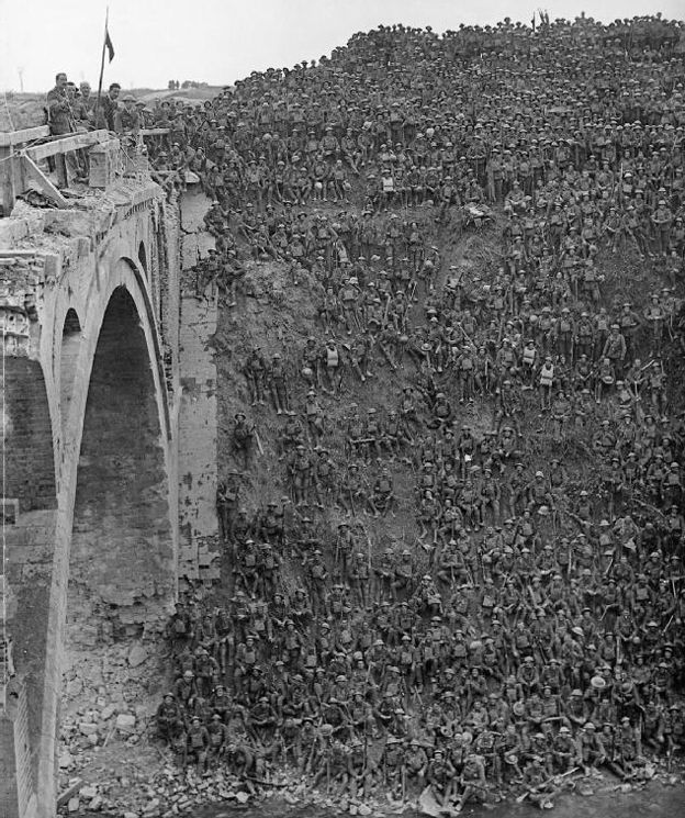 Troops en masse are sat on a big hill next to Riqueval Bridge