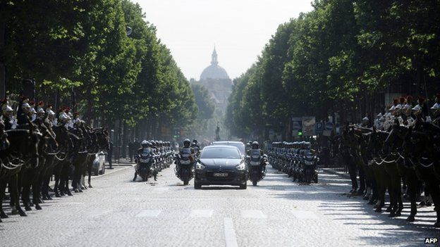 """French President Francois Hollande arrives by car on the Place de l""""Etoile on 14 July 2013 for the Bastille Day, the French National Day, parade in Paris"""