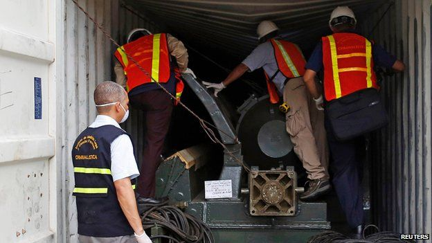 Forensic workers examine containers from North Korean ship, Colon City (17 July)