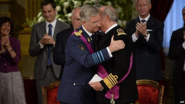 Prince Philippe hugs Albert II before the king signs the abdication treaty (21 July 2013)