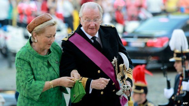 Albert II arrives with Queen Paola before a mass celebrating his 20 years as king, before he abdicates