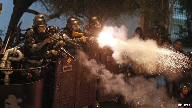 Riot police fire rubber bullets at demonstrators in Rio