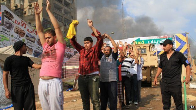 Egyptian security forces detain protesters as they clear a sit-in by supporters of ousted President Mohammed Morsi in the eastern Nasr City district of Cairo, Egypt, Aug 14, 2013