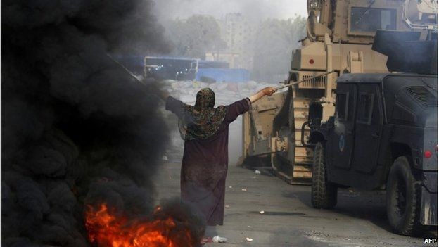 An Egyptian woman tries to stop a military bulldozer, 14 August