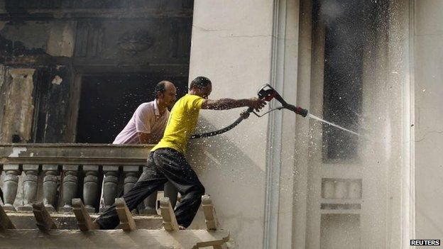 Firefighters tackle a blaze in Giza, 15 Aug