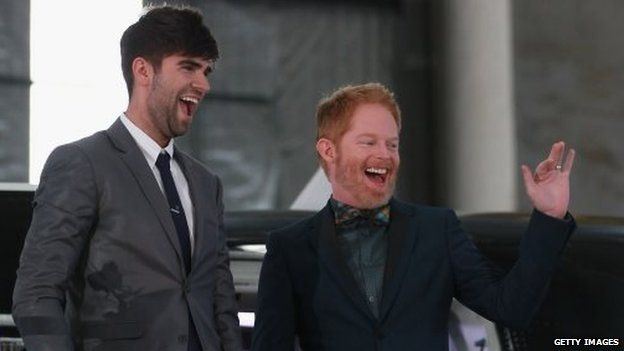 Modern Family actor Jesse Tyler Ferguson (R) and his husband Justin Mikita arrive for the reception at the Air New Zealand hanger on August 19, 2013 in Auckland, New Zealand.