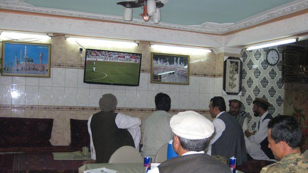 Afghan fans watch the game in a Kabul cafe
