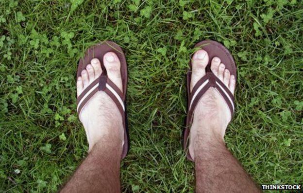 Man's sandaled feet