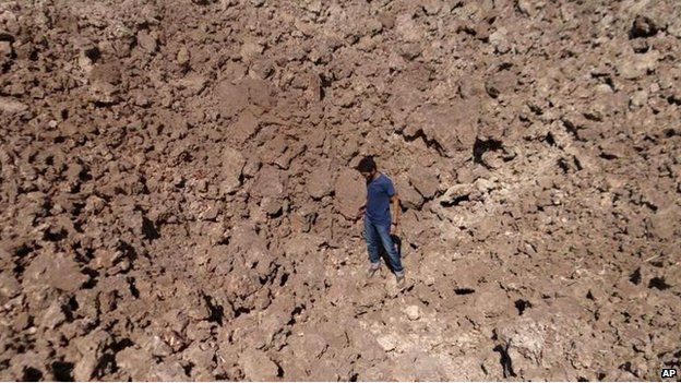 Air strike crater with man, Saraqeb, Idlib province (4 September)