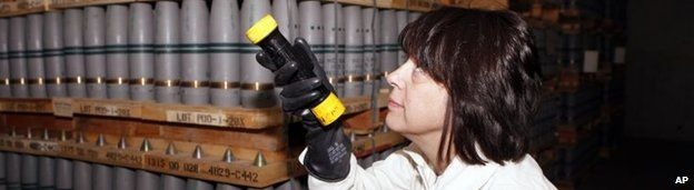 An operations manager inspects mustard agent shells in a US bunker in Pueblo, Colorado, on 21 January 2010 - some of the chemical weapons the US acknowledges it still possesses
