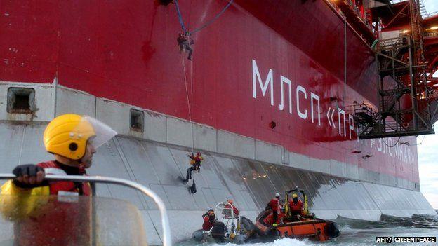 Greenpeace picture of two activists scaling side of Prirazlomnaya oil platform