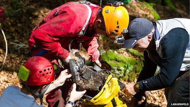 Investigators salvage wreckage from the Dornier 217