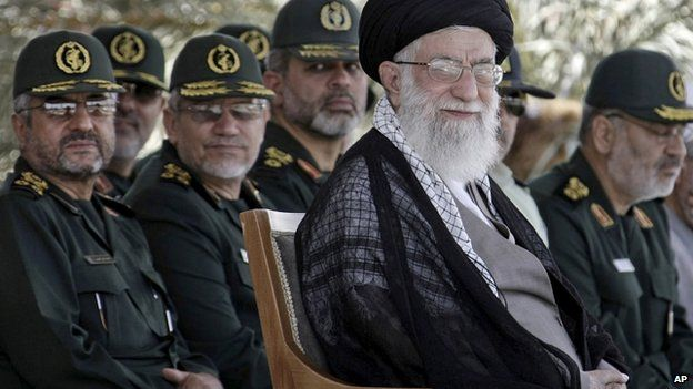 In this file photo released by the official website of the Iranian supreme leader's office on Monday, 27 May, 2013, supreme leader Ayatollah Ali Khamenei, foreground right, attends a graduation ceremony of a group of Revolutionary Guard members, in Tehran, Iran.