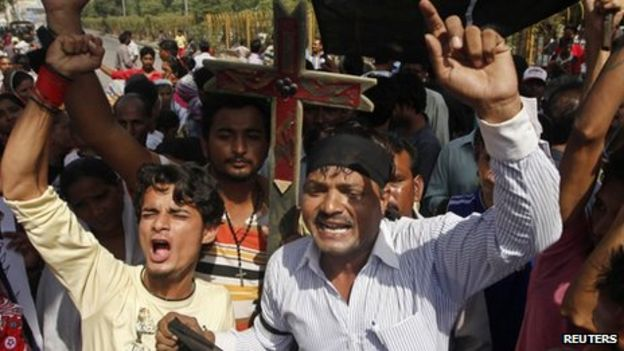 Members of the Pakistani Christian community chant slogans during a protest rally to condemn Sunday