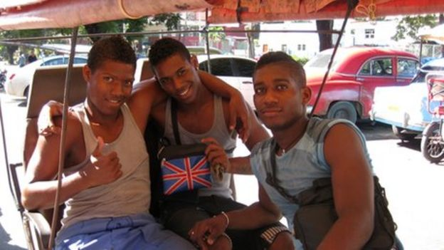 c129ae68e76 A young Cuban and his friends show off a bag emblazoned with the Union Jack
