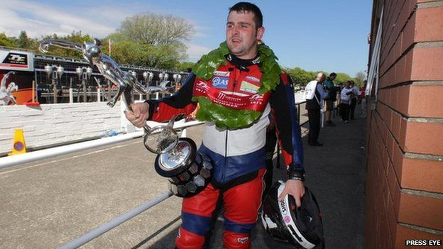 Michael Dunlop after collecting his fourth Isle of Man TT trophy of the week