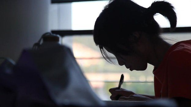 Shot of female student writing taken in October 2013