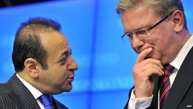 Turkish Minister for EU Affairs Egemen Bagis (L) talks to EU Commissioner for Enlargement Stefan Fuele in Brussels, 5 November